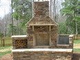 outdoor fireplace,with  woodboxes